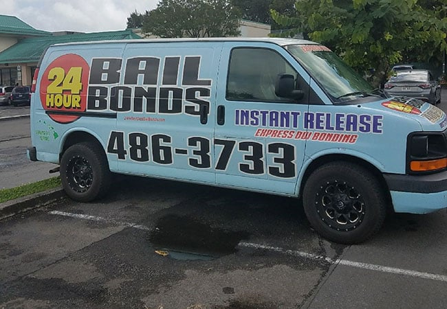 Side of the service van for 24 Hour Bail Bonds Oahu